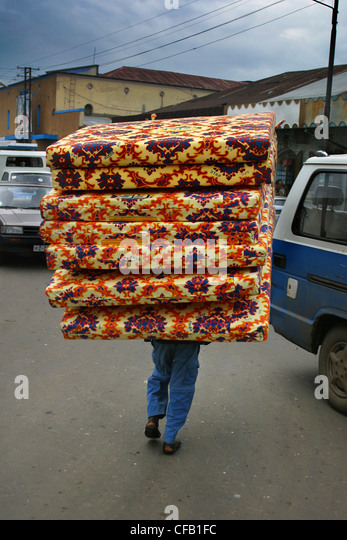 pile of mattresses. Man Carrrying Mattresses On The Street Of Addis Ababa - Stock Image Pile L