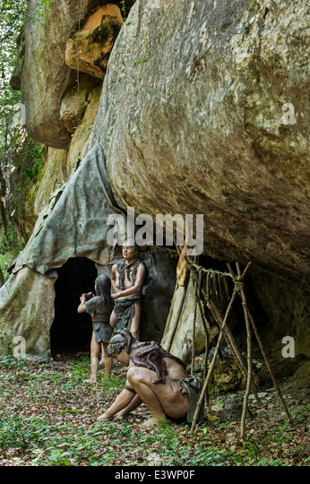 Semi-nomadic Neanderthals in camp with shelter made of animal skins ...