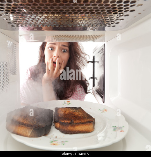 woman microwave oven stock photos amp woman microwave oven