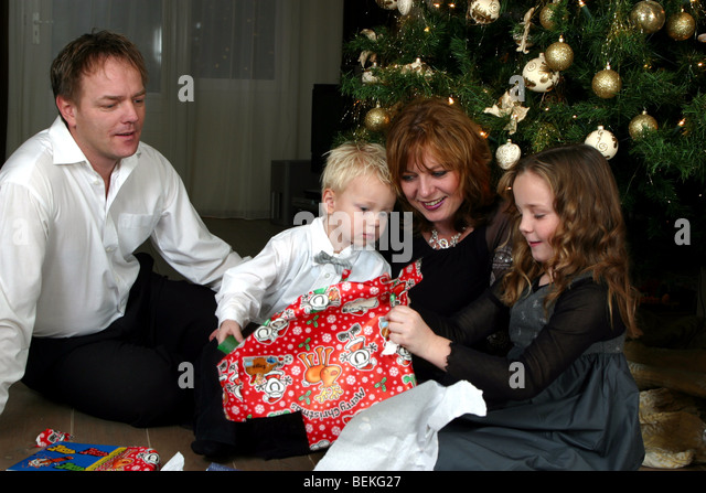 Unwrap Christmas Gifts Stock Photos & Unwrap Christmas Gifts Stock ...