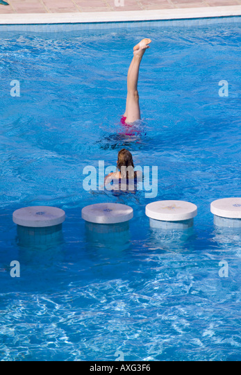 Spain Ibiza 10 13 Year Old Girl Child Female Playing Doing Handstand Stock Photo Picture And