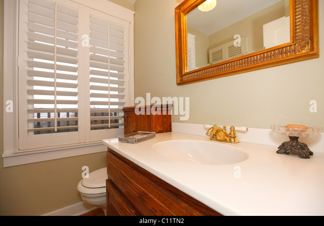 classic beige bathroom with white and wood cabinets tiles and beige walls tacoma