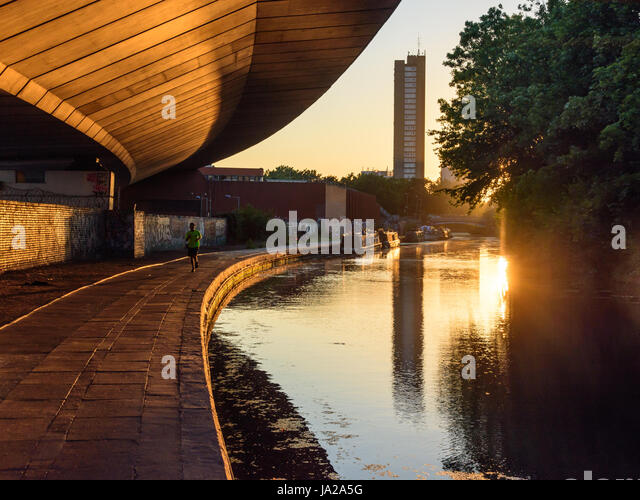London, England - July 19, 2016: The Trellick Tower housing block and Westway road flyover are reflected in the - Stock Image