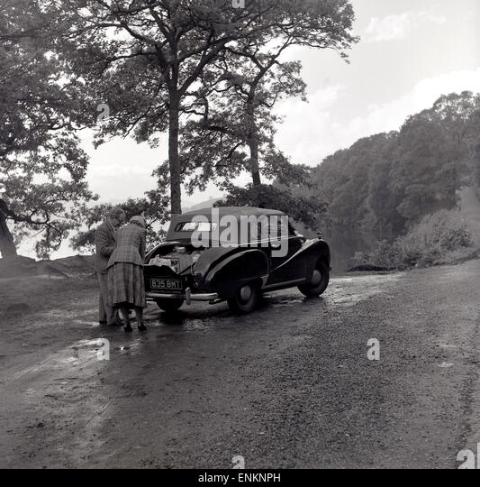 1950s Historical Couple On Motoring Holiday In Their Morris A40 Somerset Convertible Car Check