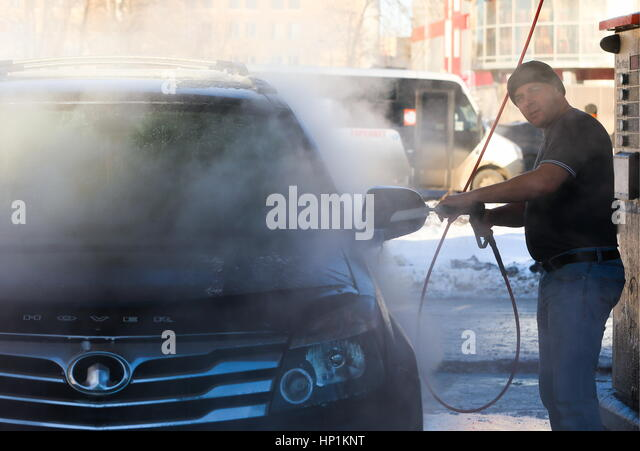 Self serve car wash stock photos self serve car wash stock a man washes his vehicle at an solutioingenieria Image collections