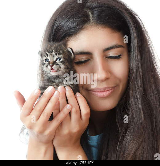 Stock Photo - Young woman gently holding a small kitten - young-woman-gently-holding-a-small-kitten-c53hex