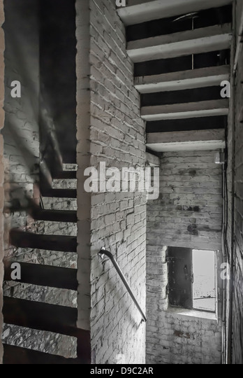 Narrow Old Staircase In Old Brick Warehouse With Dark Shadows.   Stock Image