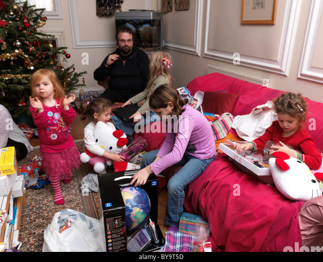 Family Around Christmas Tree Part - 50: Family On Christmas Day Opening Presents Around The Christmas Tree England  - Stock Image