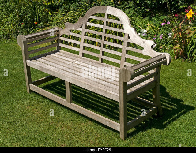 Ornate Wooden Garden Bench Seat On Green Lawn, Barnsdale Gardens, Rutland,  England,