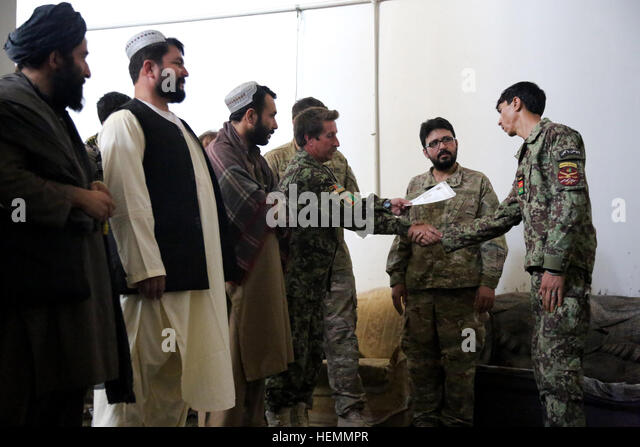 receives his diploma stock photos receives his diploma stock  an afghan national army ier shakes hands ana 205th corps 1st kankak commander as