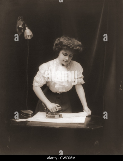 Electric Irons From The 1900s ~ S woman home stock photos
