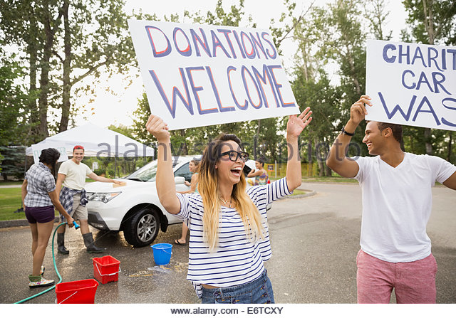 Car wash signs stock photos car wash signs stock images alamy enthusiastic volunteers waving charity car wash signs stock image solutioingenieria Gallery