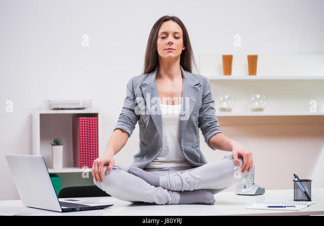 meditation office. Young Businesswoman Is Meditating In Her Office. - Stock Image Meditation Office