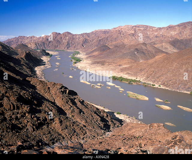 the orange river where it forms the border between south africa and namibia stock - Bordre Bad Bilder
