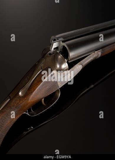 Double barrel stock photos double barrel stock images for 12 gauge shotgun lying on the floor