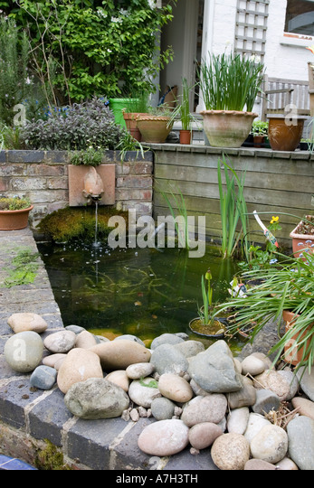 Garden pond stock photos garden pond stock images alamy Small raised ponds