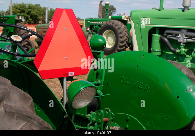 Big Slow Moving Tractor Sign : Oliver tractor stock photos images