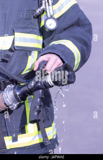 Firefighter In Action Stock Photos & Firefighter In Action ...