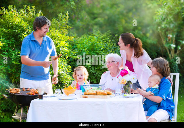 Big Brother Backyard Party : Family Eating Dinner Stock Photos & Family Eating Dinner Stock Images