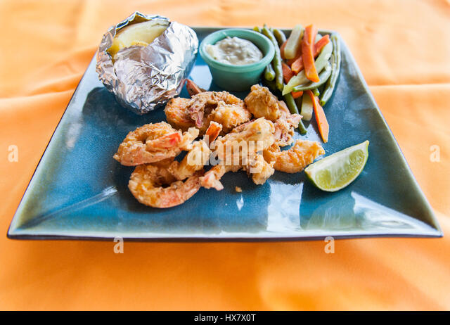 Caribbean Shrimp Baked Potato And Vegetables Stock Image