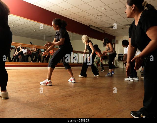 Zumba dance fitness class women stock photos zumba dance for Mirror zumba