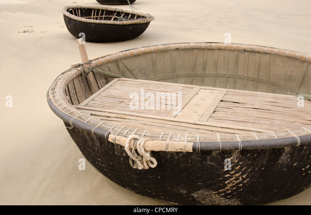 Round boat stock photos round boat stock images alamy for Round fishing boat