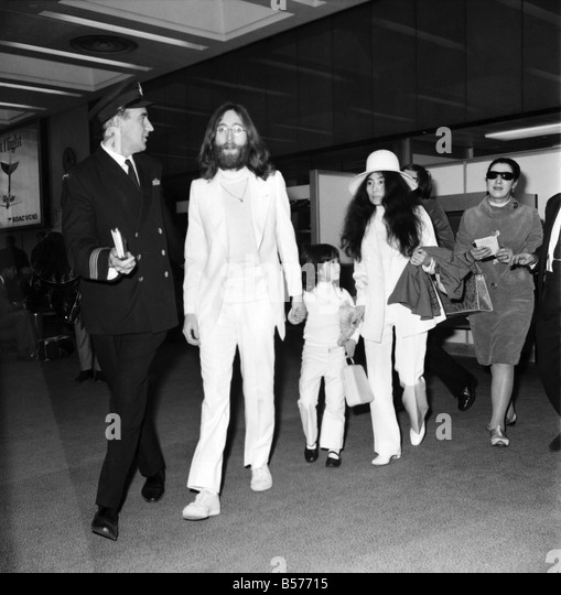 Beatle john lennon and his wife yoko ono left heathrow airport london