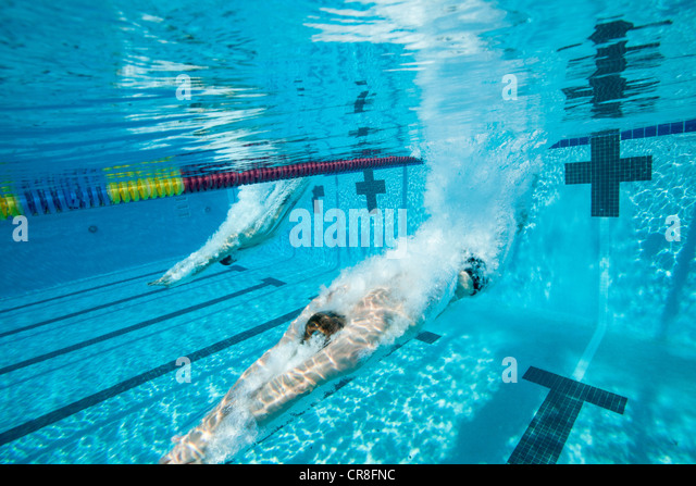 Olympic Swimming Pool Underwater olympic diving into pool stock photos & olympic diving into pool