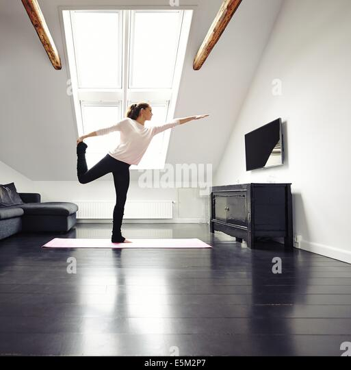 Standing on one leg home stock photos standing on one for Living room yoga timetable
