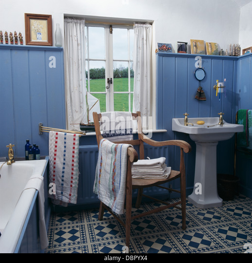 Blue Tongue+groove Paneled Walls And Blue+white Tiled Floor In Cottage  Bathroom With