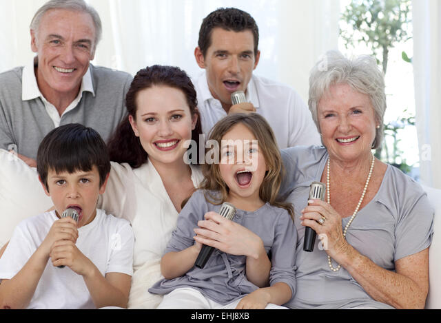 Child singing microphone in living stock photos child singing microphone in living stock for Living room karaoke