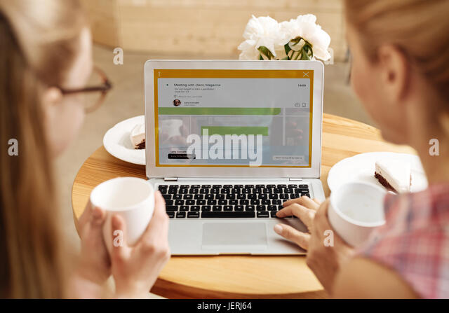 Close up of laptop running an application - Stock Image
