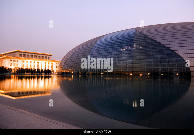 Pool outside modern house at twilight stock photos pool for Beijing opera house architect