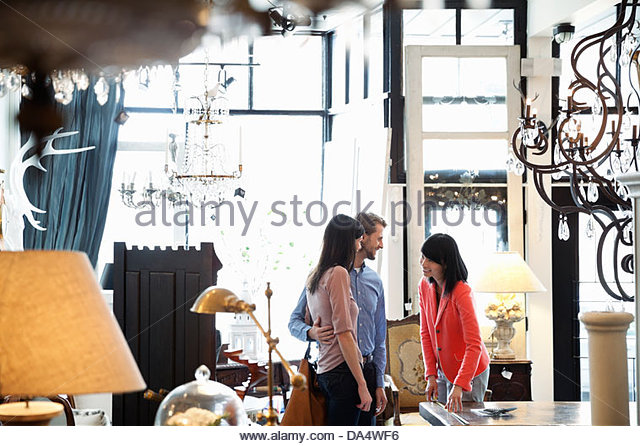 Female Business Owner Helping Customers In Furniture Store   Stock Image
