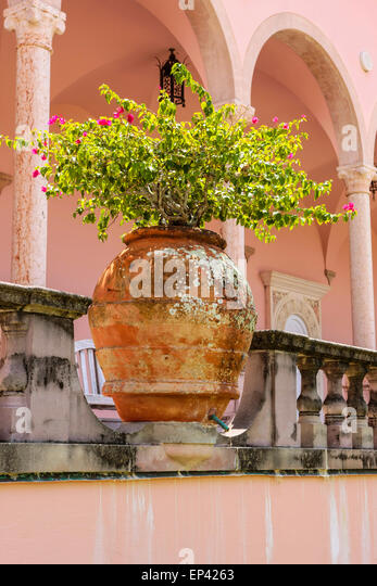 The Formal Gardens In The Style Of A Roman Courtyard With Large Terracotta  Pot At The