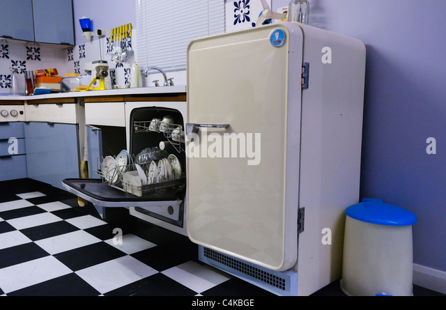 Table Top Dishwasher Hertfordshire : ... 70s seventies kitchen showing dishwasher and fridge - Stock Image
