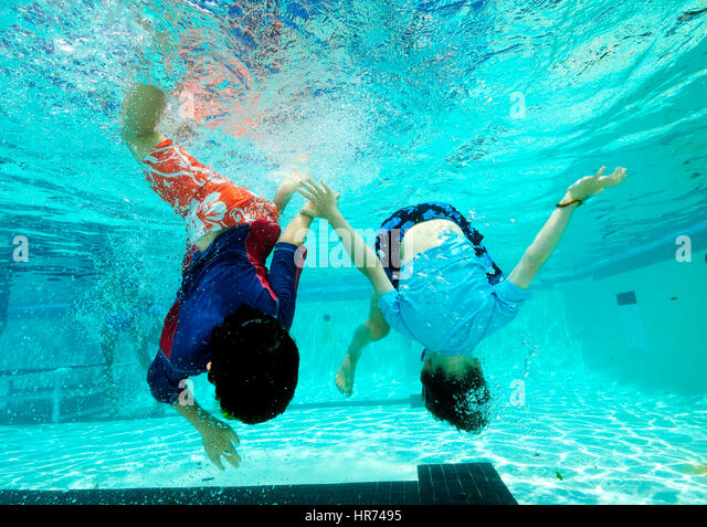Kids Swimming Underwater kids in swimming pool stock photos & kids in swimming pool stock