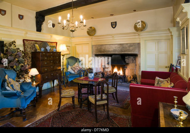Period House Sitting Room With Large Open Fire And Dining Table Chairs