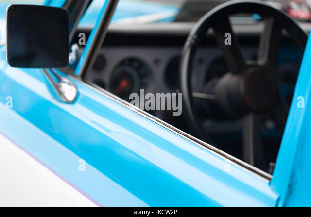wing mirror of a blue and white shiny classic vintage car stock image