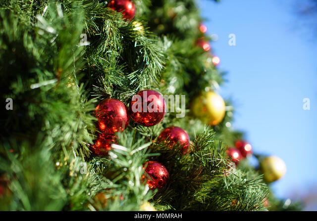 Big bright sun on red stock photos big bright sun on red for Large christmas baubles for outside