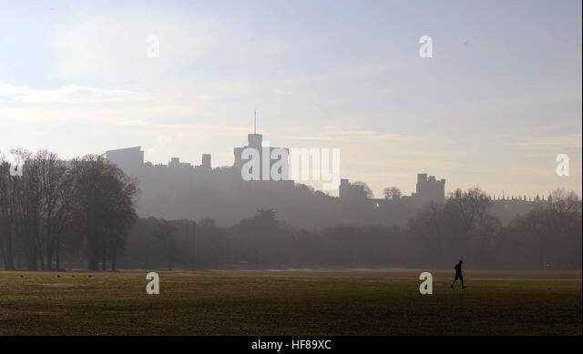 A Runner Runs Across The Public Sports Fields Of Home Park As Fog Surrounds Distinctive