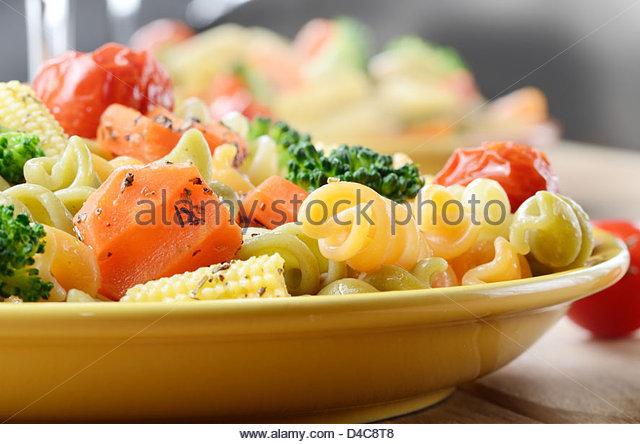 Pasta Fusilli Salad With Broccoli Carrot Corn Tomatoes Stock Image