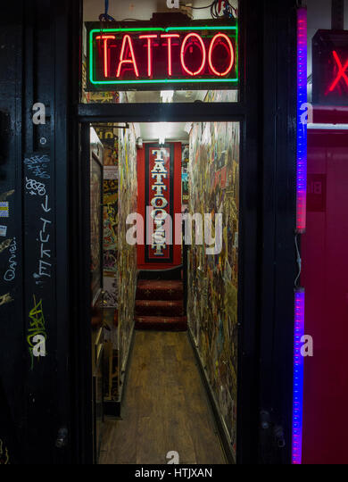 Red light district soho stock photos red light district for Tattoo shops in london