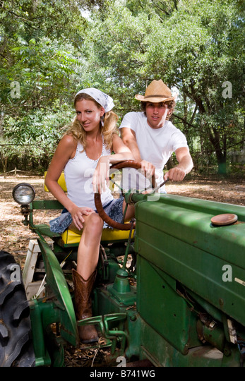 Couple On Tractor : Friends tractor stock photos