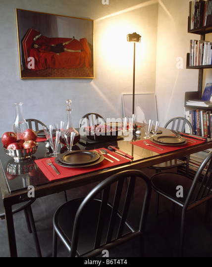 Red and black themed dining room with black plates and red placemats on  black table with. Interiors Dining Rooms Modern Pictures Stock Photos   Interiors