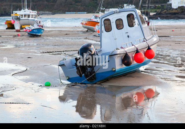 Boat boats harbour sand stock photos boat boats harbour for Small fishing boats with motor