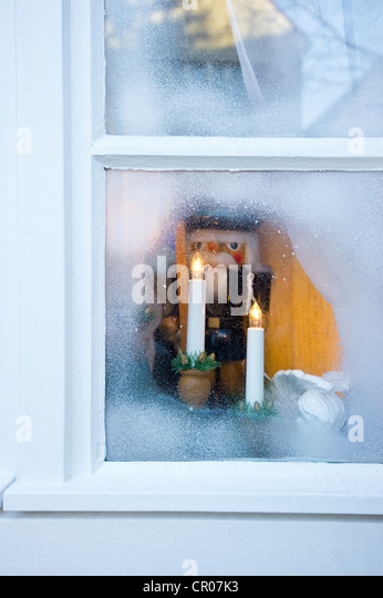 window with christmas decoration stock image