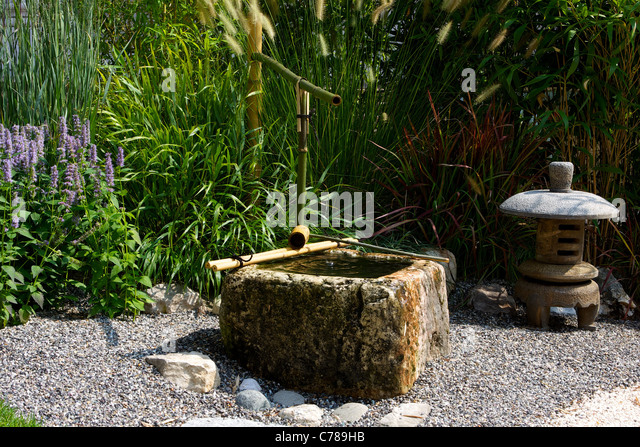 Path of pebbles stock photos path of pebbles stock for Japanese water garden plants