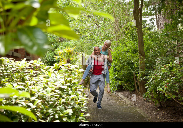 Marvelous Back Garden Stock Photos  Back Garden Stock Images  Alamy With Interesting Happy Couple Having Fun Giving Piggy Back In Garden  Stock Image With Amusing How To Pickle Peppers From The Garden Also Metal Arches For Gardens In Addition Waverley Garden Centre And Garden Furniture Table As Well As Meanwhile Gardens Skatepark Additionally Small Square Garden Design Ideas From Alamycom With   Interesting Back Garden Stock Photos  Back Garden Stock Images  Alamy With Amusing Happy Couple Having Fun Giving Piggy Back In Garden  Stock Image And Marvelous How To Pickle Peppers From The Garden Also Metal Arches For Gardens In Addition Waverley Garden Centre From Alamycom