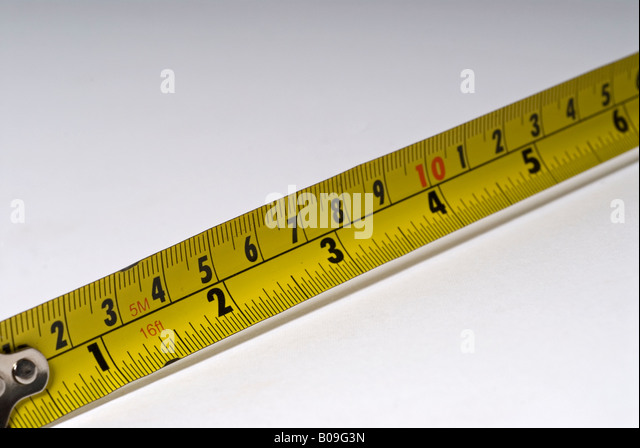 stock photo of a tape measure showing both the metric and imperial stock image